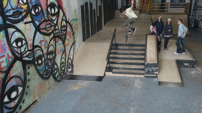 Brice Bangs draws the attention of other skateboarders while he practices a trick at Waterboyz indoor skate park.