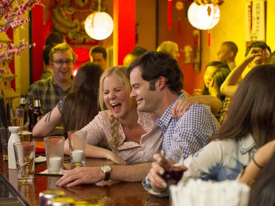 "Bill Hader and Amy Schumer in ""Trainwreck."""
