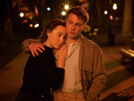 Saoirse Ronan and Emory Cohen appear in a scene from