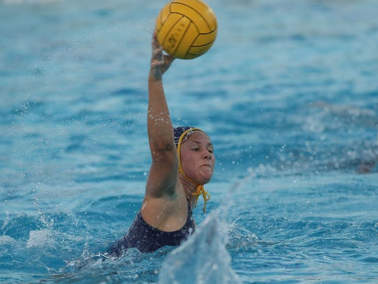 Lauren Olivier of La Quinta scores against Xavier Prep