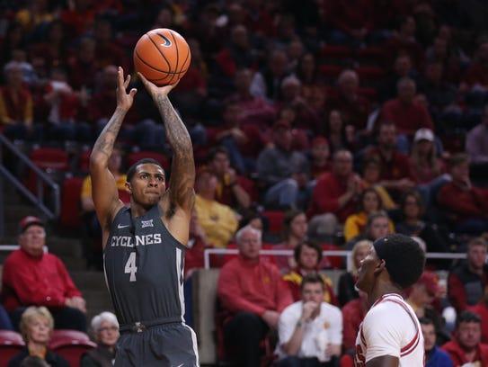 Iowa State's Donovan Jackson shoots a three during