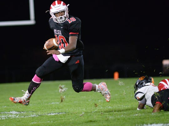 Delsea's Edison Echevarria runs the ball during Friday night's game against Woodrow Wilson. 10.27.17. Joe Warner/For the Courier-Post