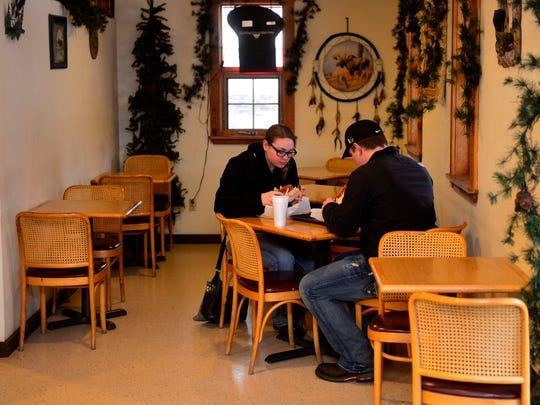 Customers enjoy sandwiches at Montana Sub Shop.