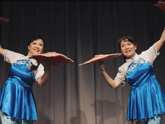 Jirong Lu (left) and Ling Liu perform a traditional Chinese dance.