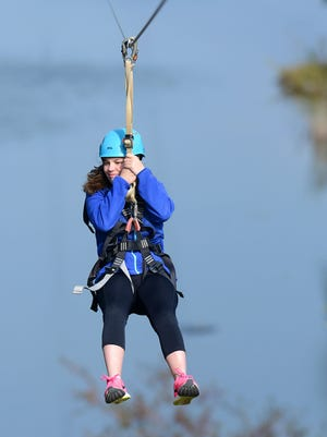 Bethany Torstenson, 17, begins her trip down the zip line at the NEW Zoo Adventure Park in Suamico.