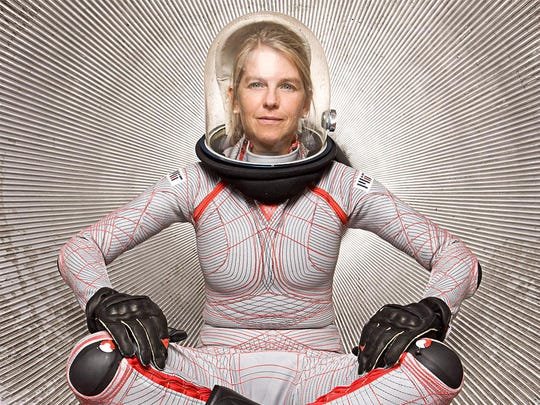Dava Newman poses wearing a prototype of the BioSuit