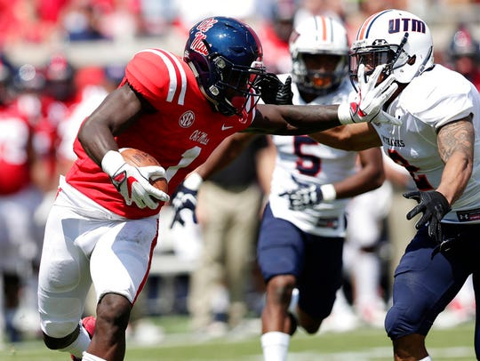 Mississippi wide receiver A.J. Brown (1) fights off