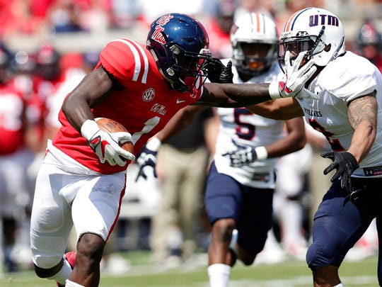 Mississippi wide receiver A.J. Brown (1) fights off a tackle attempt by Tennessee Martin safety Joseph Este (2) as he returns a punt in the second half of an NCAA college football game in Oxford, Miss., Saturday, Sept. 9, 2017. Mississippi won 45-23. (AP Photo/Rogelio V. Solis)