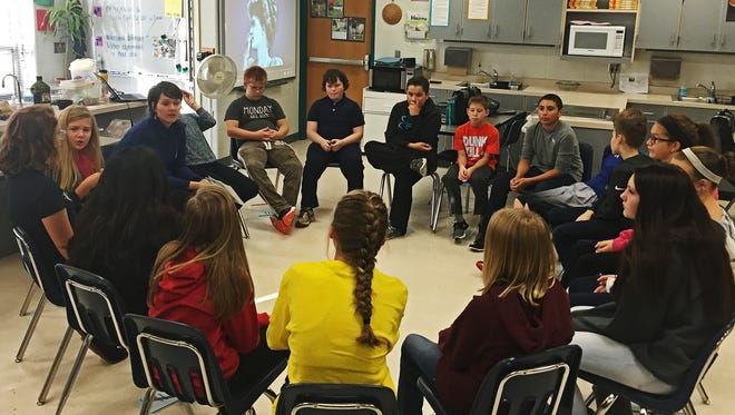 Teacher Brittany Henry leads her seventh-grade class in a discussion on empathy on Oct. 18, 2016. The special class period is part of Memorial Middle School's bullying prevention curriculum.