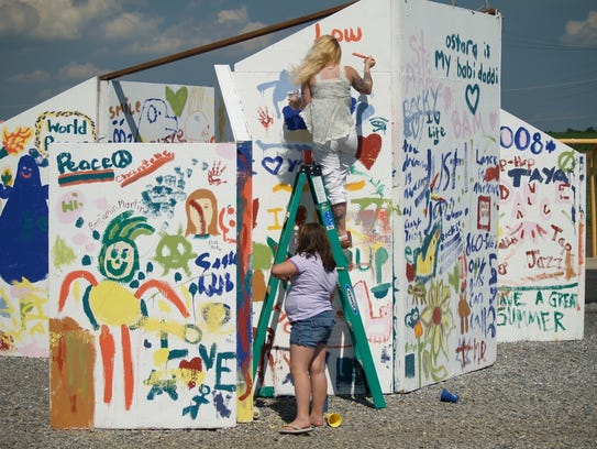 Everybody gets into the act at the Solstice Art Wall.