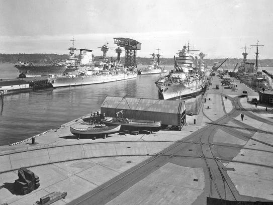 1937: Battleships and a carrier at the Navy Yard's Piers 5 and 6. (Official U.S. Navy photo)