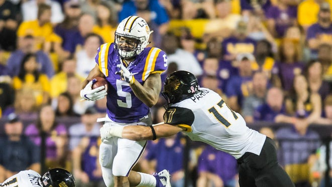 LSU Tigers running back Derrius Guice (5) rushing for another first down for the Tigers before he is tackled by Eagles linebacker Elijah Parker (17) on Saturday October 15, 2016 BUDDY DELAHOUSSAYE/ THE ADVERTISER