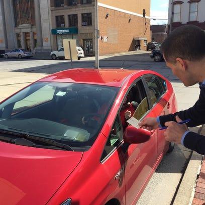 Molinaro working as parking attendant