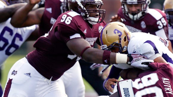 Mississippi State defensive linemen Denico Autry (90) and Chris Jones (96) sack Alcorn State quarterback John Gibbs (3) during the first quarter of their NCAA college football game at the Davis Wade Stadium, Saturday, Sept. 7, 2013 in Starkville, Miss. Mississippi State won 51-7. (AP Photo/Rogelio V. Solis)