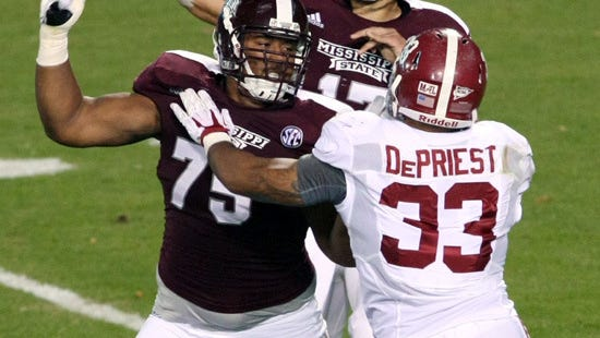 Mississippi State quarterback Tyler Russell (17) tries to pass behind the block of offensive linesman Blaine Clausell (75) as Alabama linebacker Trey DePriest (33) rushes during the second half of an NCAA college football game on Saturday, Nov. 16, 2013, in Starkville, Miss. (AP Photo/Kerry Smith)