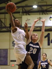 Franklin's Nailah Blount, left, goes up for a shot against Coronado's Meagan Bean, 20. Franklin prevailed 40-29.