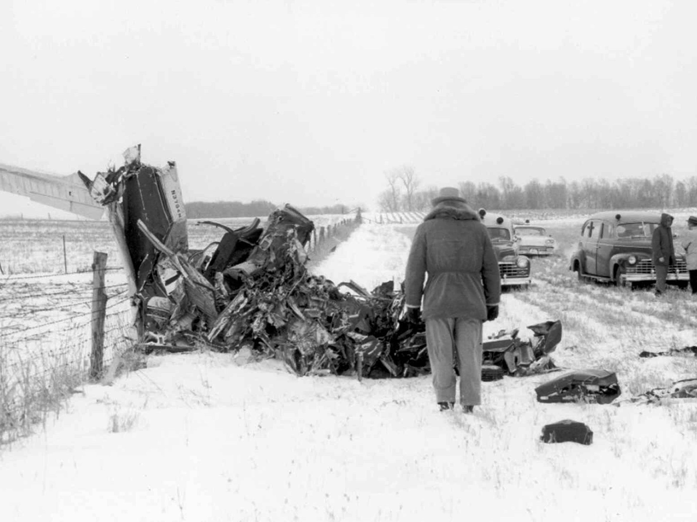 Officials survey the wreckage on Feb. 3, 1959, of a
