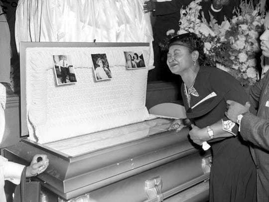 Mamie Till Mobley weeps at her son's funeral on Sept. 6, 1955, in Chicago.  Till, mother of Emmett Till, insisted that her son's body be displayed in an open casket forcing the nation to see the brutality directed at blacks in the South at the time.