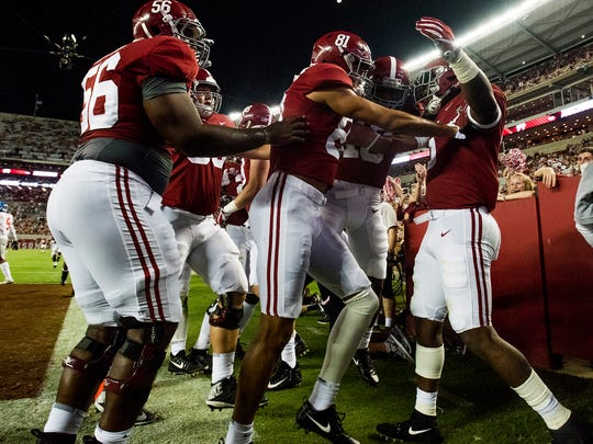 Alabama tight end Ronnie Clark, right, celebrates a touchdown  against Ole Miss in second half action at Bryant-Denny Stadium in Tuscaloosa, Ala. on Saturday September 30, 2017. (Mickey Welsh / Montgomery Advertiser)