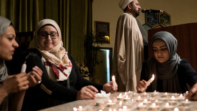 Imam Hassan Habhab, center right, recites verses of guidance from the Quran before a candlelight vigil on Thursday, June 16, 2016 at the Islamic House of Wisdom in Dearborn Heights. Tim Galloway/Special to DFP