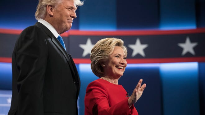 Democratic presidential nominee Hillary Clinton (right) stands with Republican presidential nominee Donald Trump at the start of the first presidential debate Sept. 24 at Hofstra University in Hempstead, New York.