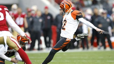 Andy Dalton pumps up the team during warm ups before the Cincinnati Bengals took on the San Francisco 49ers on Sunday.