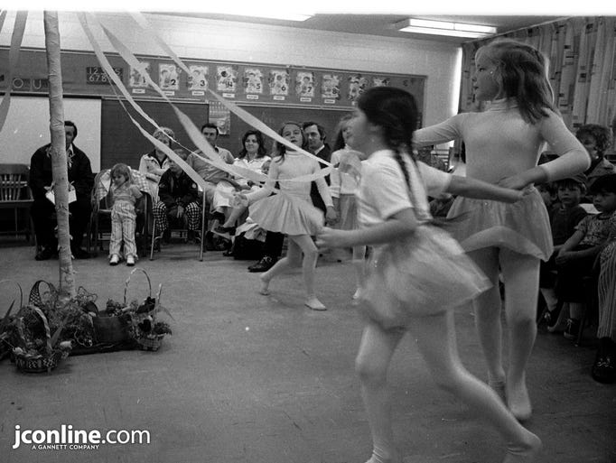 Burtsfield School pupils perform a traditional may pole dance for their retiring first-grade teacher. Photo taken May 12, 1974.