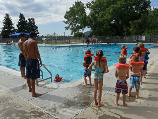 Children take swimming lessons at the Bowers mansion