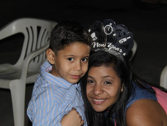 Thashaina Seraus shares a moment with her son, Thyshawn,