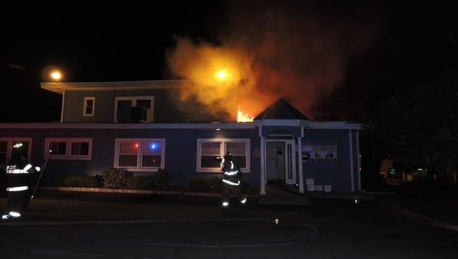 Flames erupt from a commercial building at 263 N. Main St. in Hillcrest, Sept. 25, 2014.