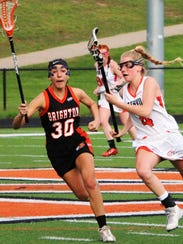 Northville's Sarah Chase (right) goes on the attack