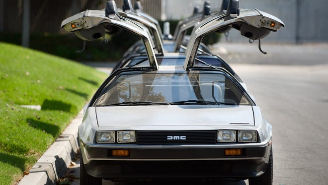 This Sept. 10, 2013 photo shows DeLorean cars parked outside The DeLorean Motor Company in Huntington Beach, Calif.