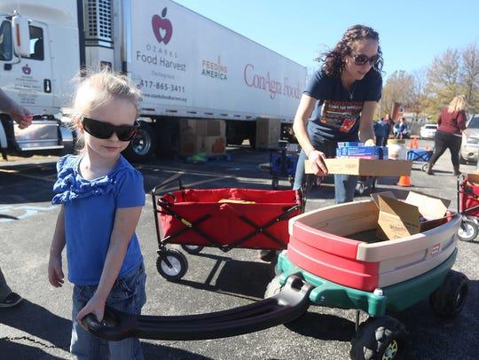 Ozarks Food Harvest distributes food at Reed Middle