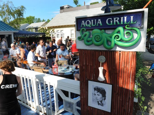 Aqua Grill is the place to be seen at Happy Hour, with a meet 'n greet outdoor deck with abundant drinks and handsome wait staff.