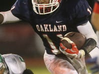 Oakland's Kyle Oliver avoids a tackle in the first half of a 35-14 victory over White Station at Oakland on Friday night.