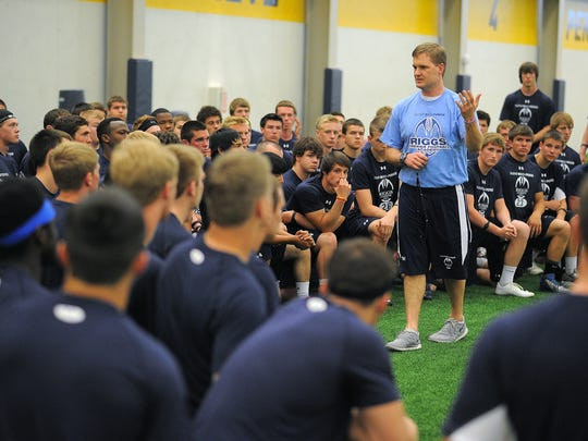 Kurtiss Riggs speaks to high school players at the Sanford Power Riggs Football Academy and recruiting combine at the Sanford Fieldhouse in Sioux Falls.