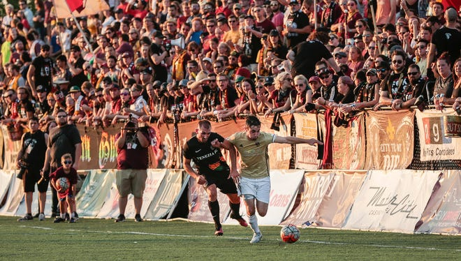 Detroit City FC's Zach Schewee, right, is defended by Venezia FC's Gianni Fabiano during a friendly match at Keyworth Stadium, July 18, 2017 in Hamtramck.