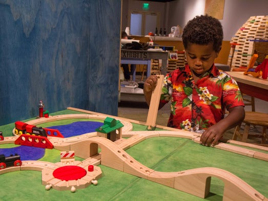 Solomon Rudavsky, 4, plays in the Discovery Station and Craft Corner at Conner Prairie. The new, renovated room opens to the public June 28 and offers an indoor play space for children. Solomon is the son of Indianapolis Star reporter Shari Rudavsky.
