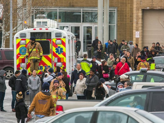 Police and fire personnel escort shoppers out of The Mall in Columbia.