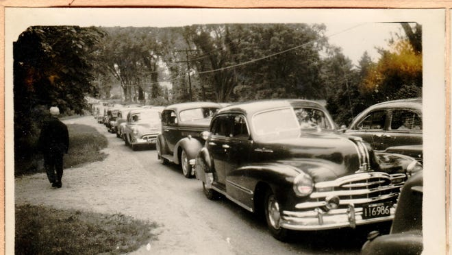A photo taken by Charles Gleason of Hanover circa 1950 showing traffic back to Boston on a Sunday afternoon on what is now Route 53  somewhere near the North Pembroke and Hanover line. Stephen O'Neill, executive director  of the Hanover Historical Society said they have hundreds of local photos taken by Gleason who kept detailed scrapbooks.