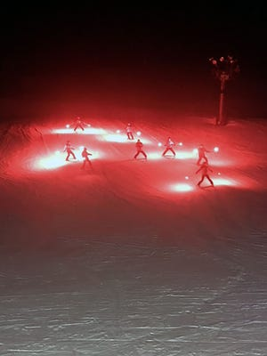 An urn containing the ashes of Jane Herte is given one last run at Little Switzerland ski area in Slinger. The ski patrol illuminated the hill with torches while their director carried the urn. Herte's father opened the ski hill in 1941 and she spent most of her life working and skiing there. She died Jan. 30.