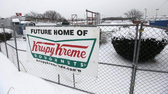 Construction continues on the new Krispy Kreme that is being built on U.S. 13 across from the New Castle Airport, Monday, March 17, 2014. Krispy Kreme is hiring managers now and expects to open in early June.