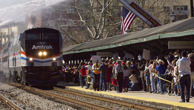 Tallahassee residents gathered for the arrival of the first Amtrak train since 2005 at the Railroad Avenue Station on February 19, 2016.