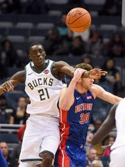 Bucks guard Tony Snell and Detroit Pistons forward Jon Leuer battle for a rebound.