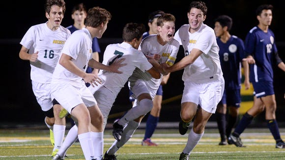 Reynolds player celebrate a goal in Monday's 3-3 tie