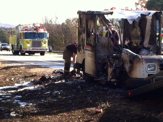 U.S. Post Office vehicle destroyed by fire(Photo: Brian Holt, WBIR)