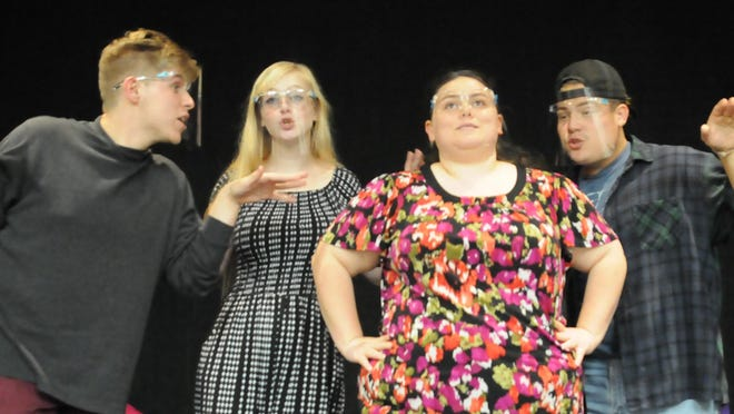 """Ethan Badders, from left, as Jeff, Abby Wray, as Heidi, Paula Rolph, as Susan, and Brody Carrasco, as Hunter, practice the """"Die, Vampire, Die!"""" scene in the upcoming Kansas Wesleyan student musical """"[title of show]"""" that will be showing at the Fitzpatrick Auditorium from Sept. 25-27."""