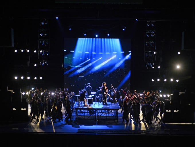 Pink's band plays a fateful concert in Act I in the