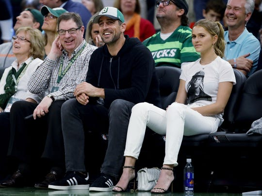 Aaron Rodgers of the Packers sits courtside at Game 5 of the Eastern Conference finals with Mallory Edens to his left. Edens wore a Pusha T t-shirt, a nod to the feud between that rapper and notable Toronto fan Drake.