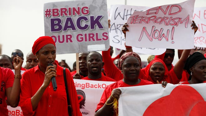 People attend a demonstration calling on the government to rescue the kidnapped girls of the government secondary school in Chibok, in Abuja, Nigeria, on May 22.